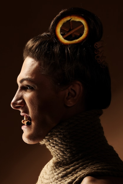 Creative image with orange and cinnamon in a hairstyle Free Photo