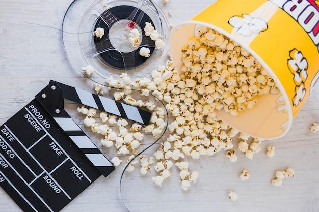 Creative layout of popcorn and movie film Free Photo