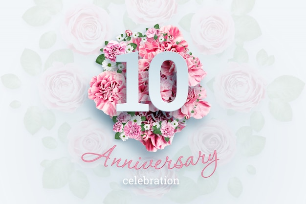 Creative lettering 10 numbers and anniversary celebration text on pink flowers., celebration event, template, flyer Premium Photo