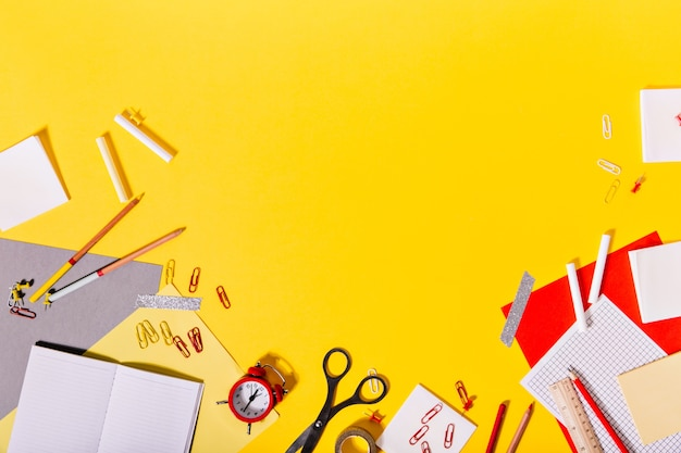 Creative mess of colorful school supplies on desk. Free Photo