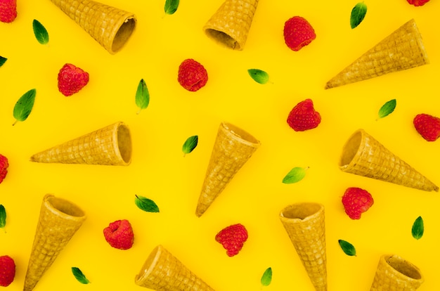 Creative pattern with raspberry and cornets Free Photo