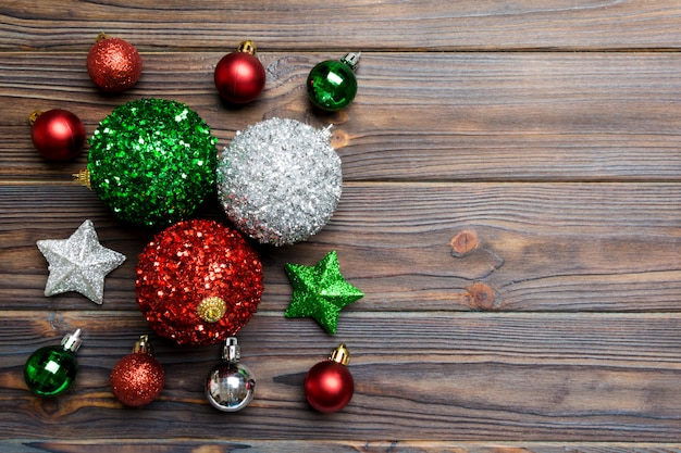 Creative set of new year baubles and decorations on wooden background Premium Photo