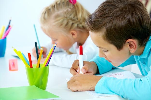 Creative students working hard Free Photo