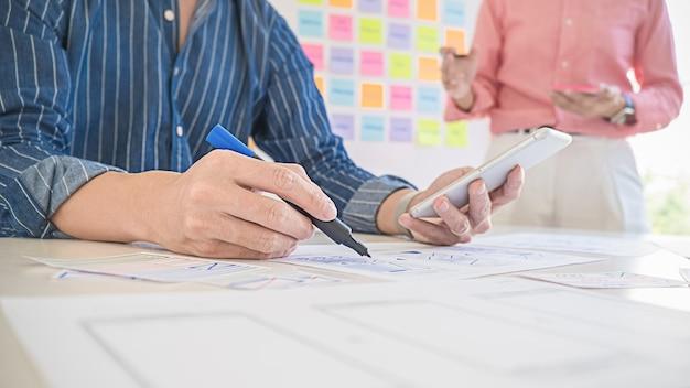 Creative web designer planning application, framework for mobile phone. user experience (ux) concept. Premium Photo