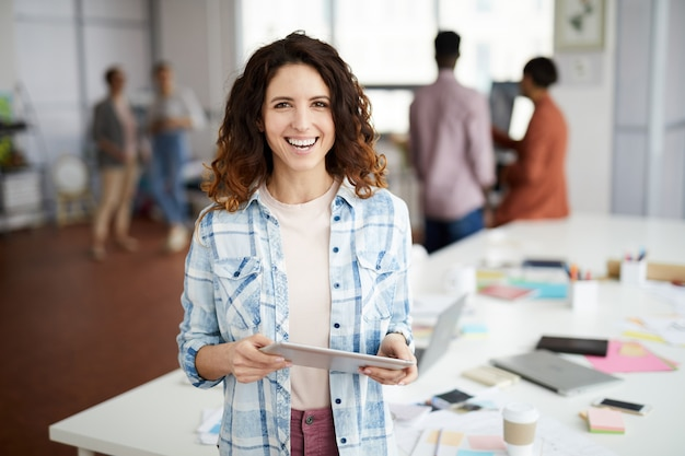 Creative woman smiling in office Premium Photo