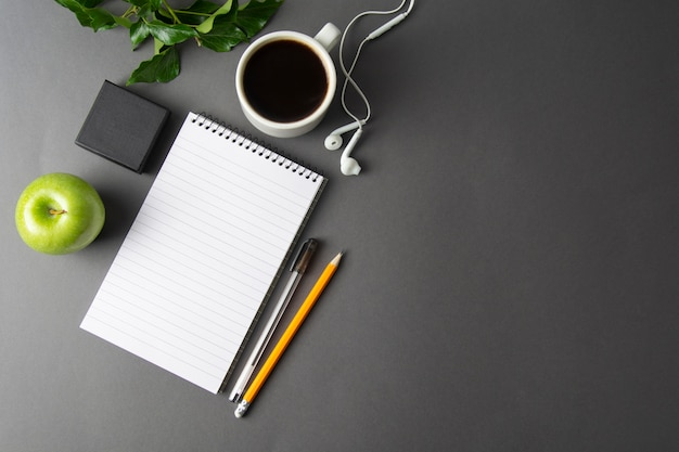 Creative work space, desk. notebook and coffee cup. mockup. Premium Photo