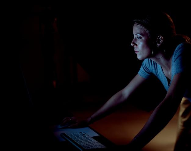 Creative working on the computer in a studio Premium Photo