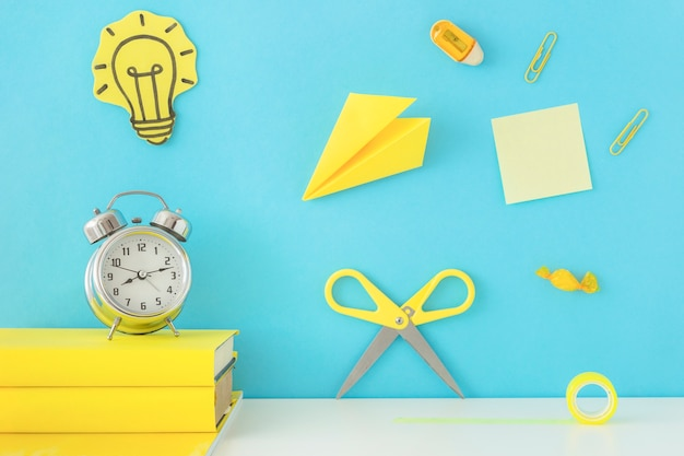 Creative workplace for inspiration with yellow writing accessories Free Photo