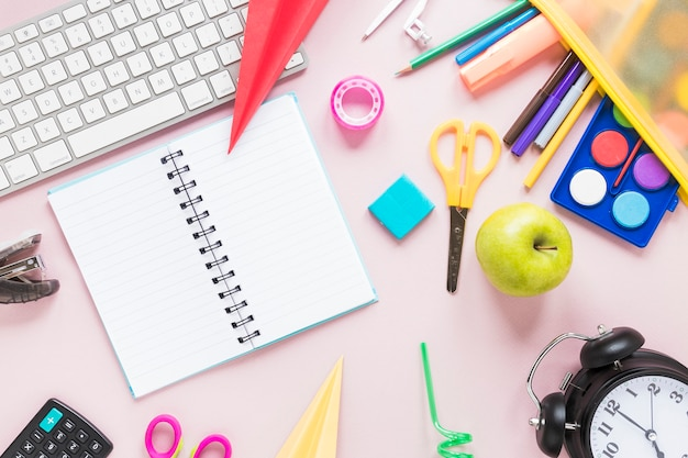 Creative workspace with notebook and school supplies Free Photo