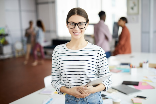 Creative young woman posing in office Premium Photo