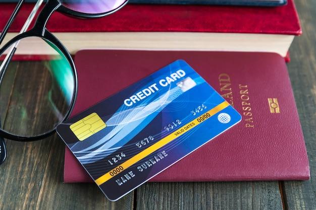 Premium Photo | Credit card put on passport on wooden desk , preparation for traveling concept