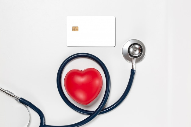 Credit card and stethoscope with red heart Free Photo