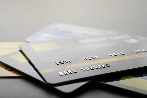 Credit cards that are stacked on the floor Free Photo