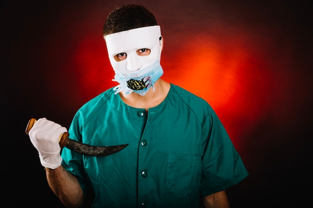 Creepy man in doctor costume Free Photo