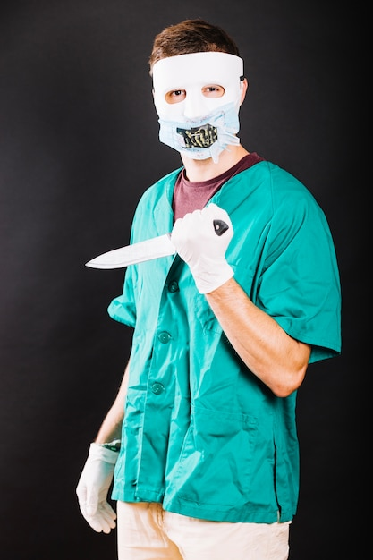 Creepy man wearing halloween costume Free Photo