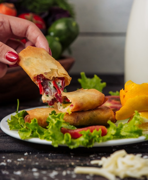 Crepe with cheese and vegetables in the plate Free Photo