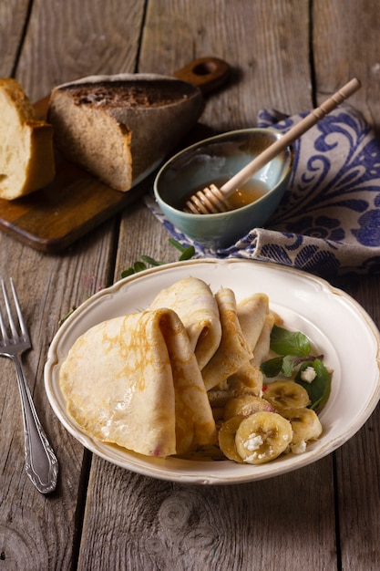 Crepes with bananas and honey Free Photo