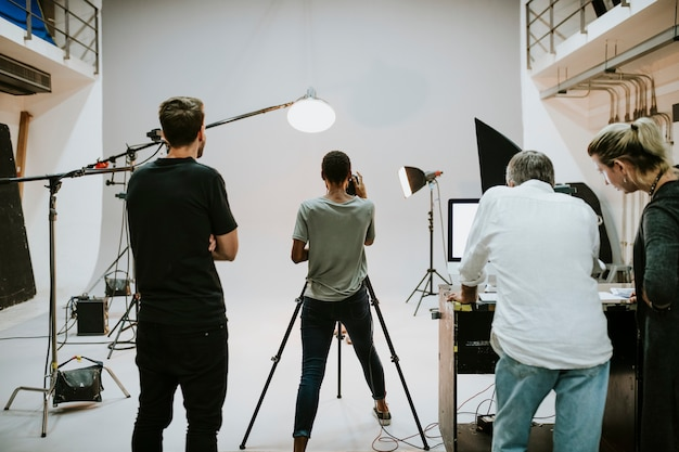 Crew working together in the studio Premium Photo