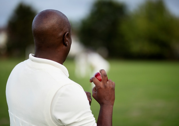 Cricket bowler ready to pitch the ball Premium Photo