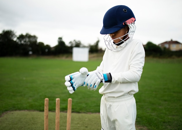 Cricket player getting ready to play Premium Photo