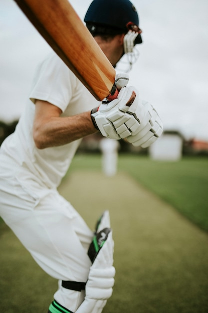 Cricketer on the field in action Premium Photo