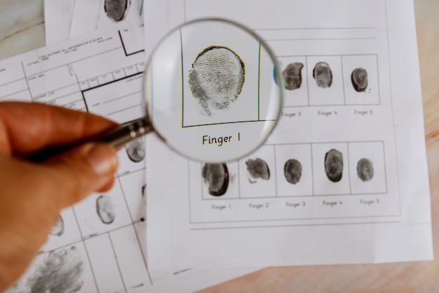 Criminal fingerprint card and magnifier criminal investigation Premium Photo