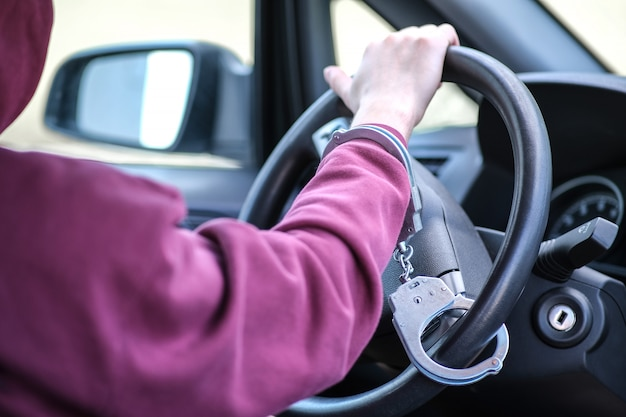 The criminal was caught stealing a car. Premium Photo