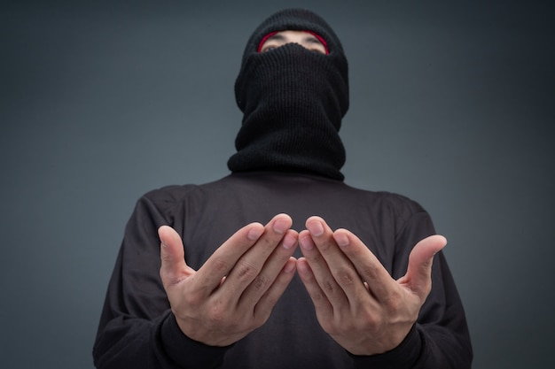 Criminals wear a mask in black on gray Free Photo