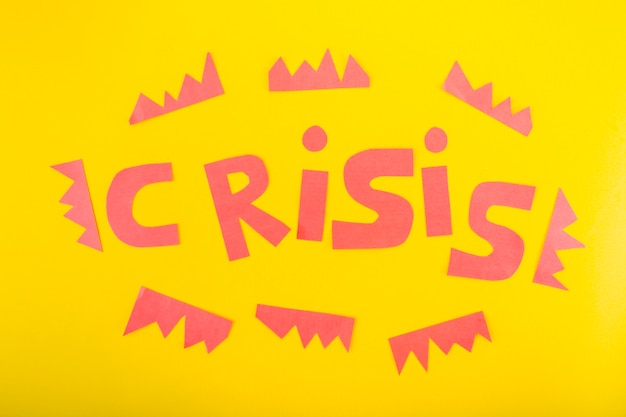 Crisis lettering of paper Free Photo