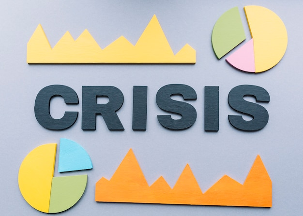Crisis word surrounded by various graph on grey backdrop Free Photo