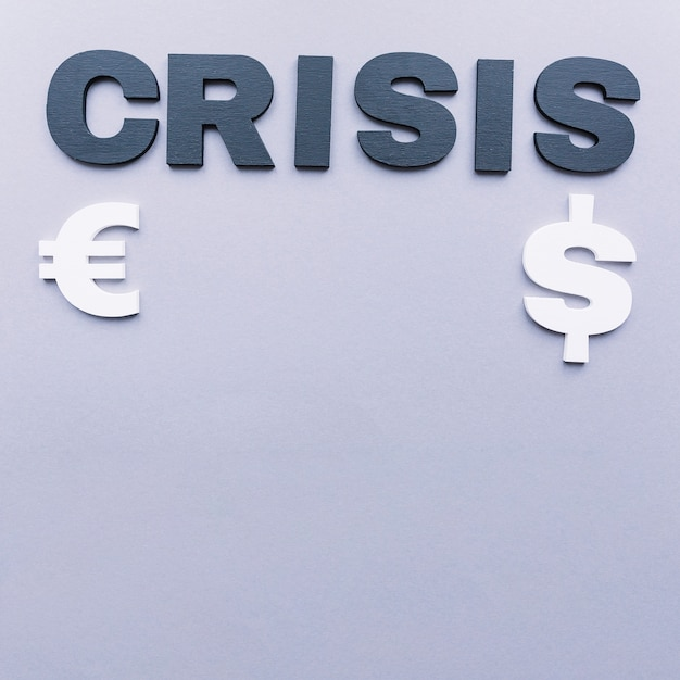 Crisis Word With Euro And Dollar Symbol On Grey Background Photo