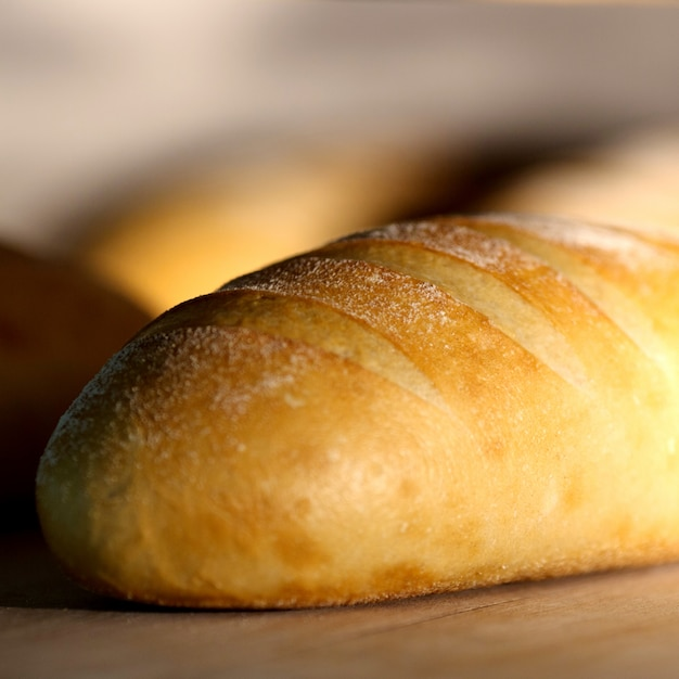 Crisp white bread loaf coated with white powder Free Photo