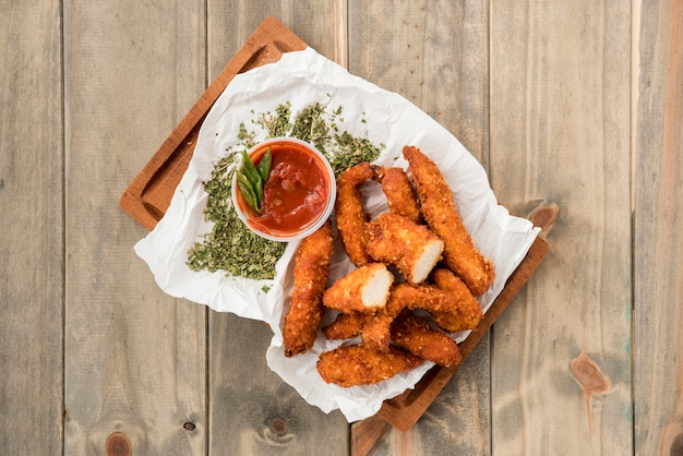 Crispy chicken nuggets with spices and sauces Free Photo