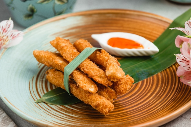 Crispy chicken nuggets with spicy sauce Free Photo