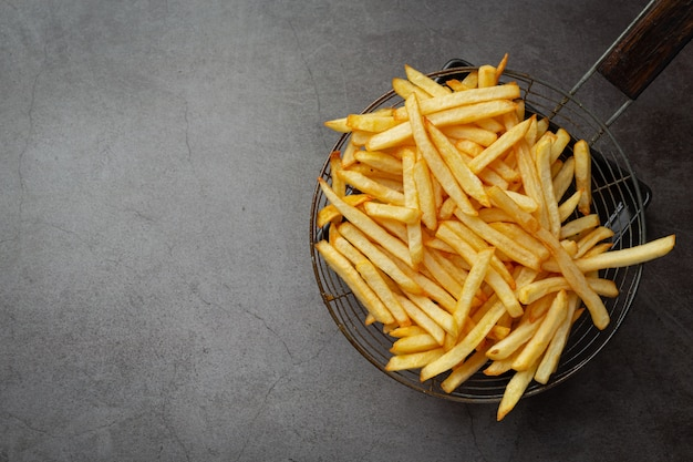 Crispy french fries with ketchup and mayonnaise. Free Photo