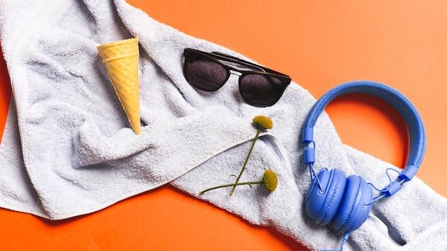 Crispy ice cream cones and summer accessories on towel Free Photo