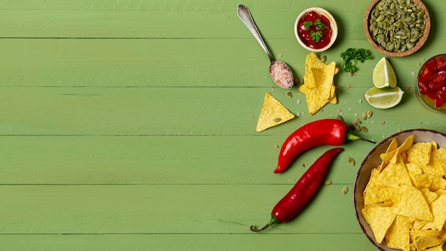 Crispy nachos and vegetables on plates Free Photo