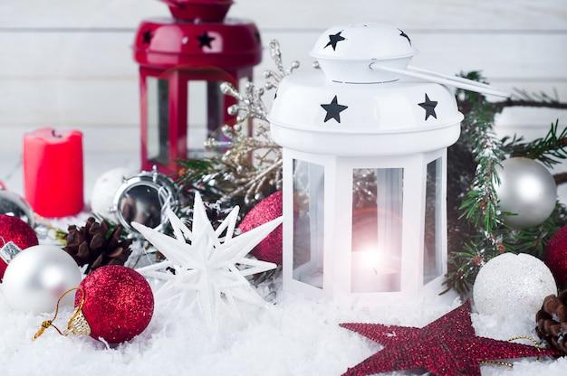 Cristmas lantern with decorations and snow Premium Photo