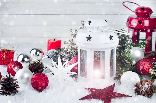 Cristmas lantern with decorations and snow Premium Photo