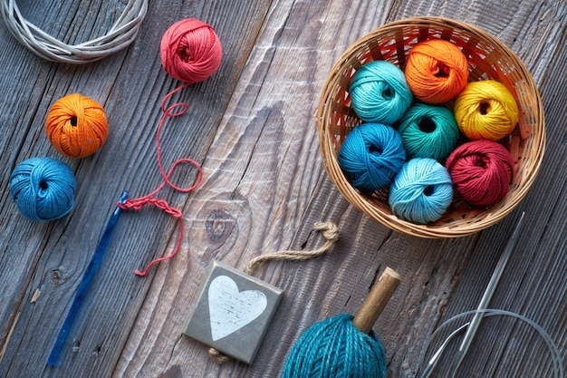 Crochet, top view on yarn balls on rustic wood Premium Photo
