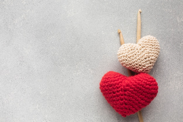 Crocheted heart shapes with copy space background Free Photo