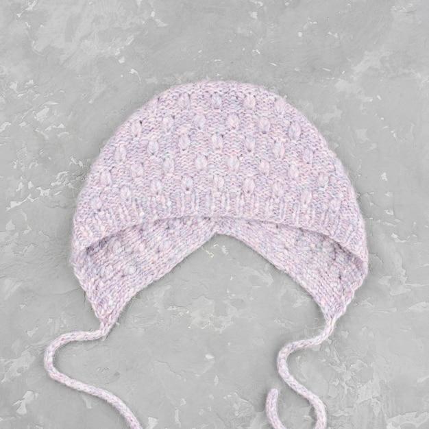 Crocheted purple hat on slate background Free Photo