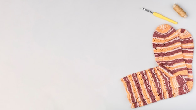 Crocheted socks with copy space Free Photo