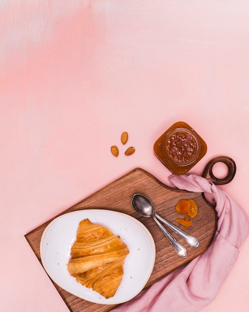 Croissant and jam in flat lay Free Photo