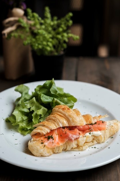 Croissant with fresh salmon Free Photo