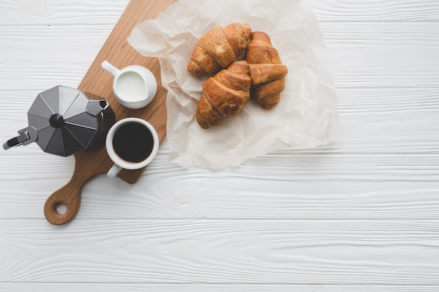 Croissants and coffee for breakfast Free Photo
