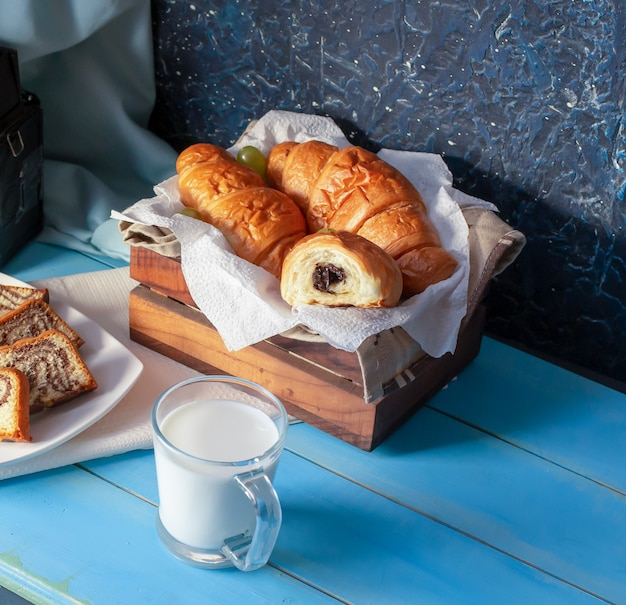 Croissants with chocolate cream and a cup of milk. Free Photo