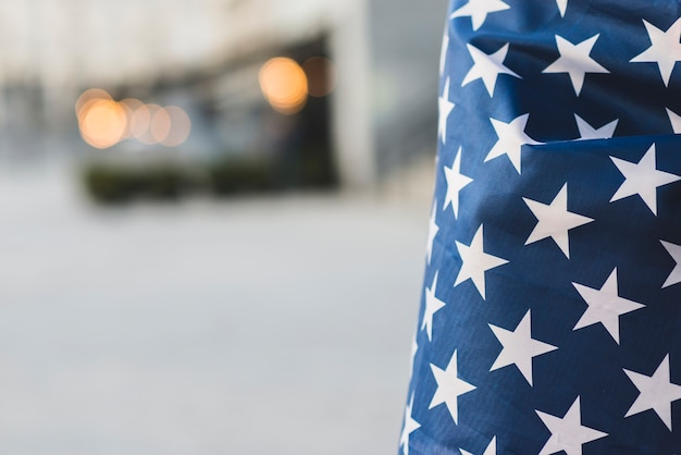Crop american flag with wrapped person Free Photo