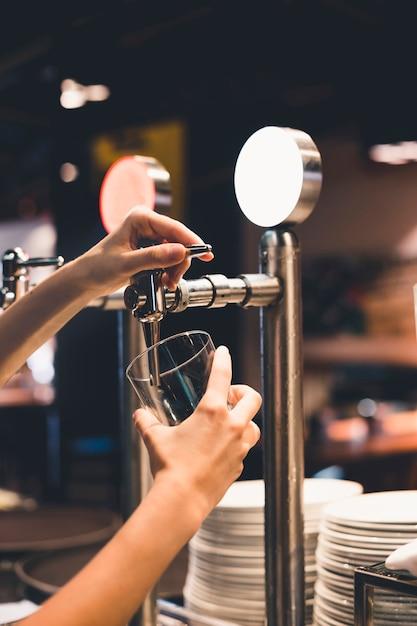 Crop bartender pouring drink 23 2147830583