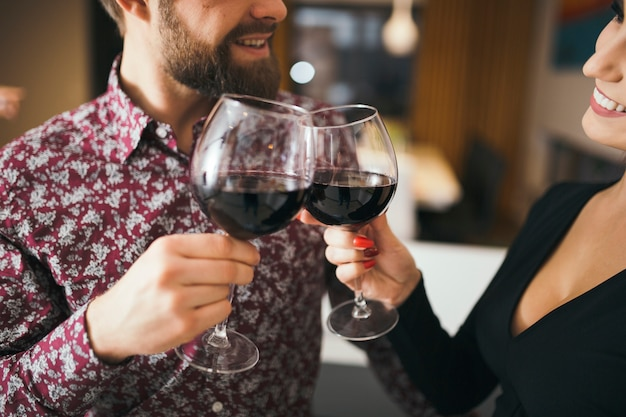 Crop cheerful couple celebrating with wine Free Photo